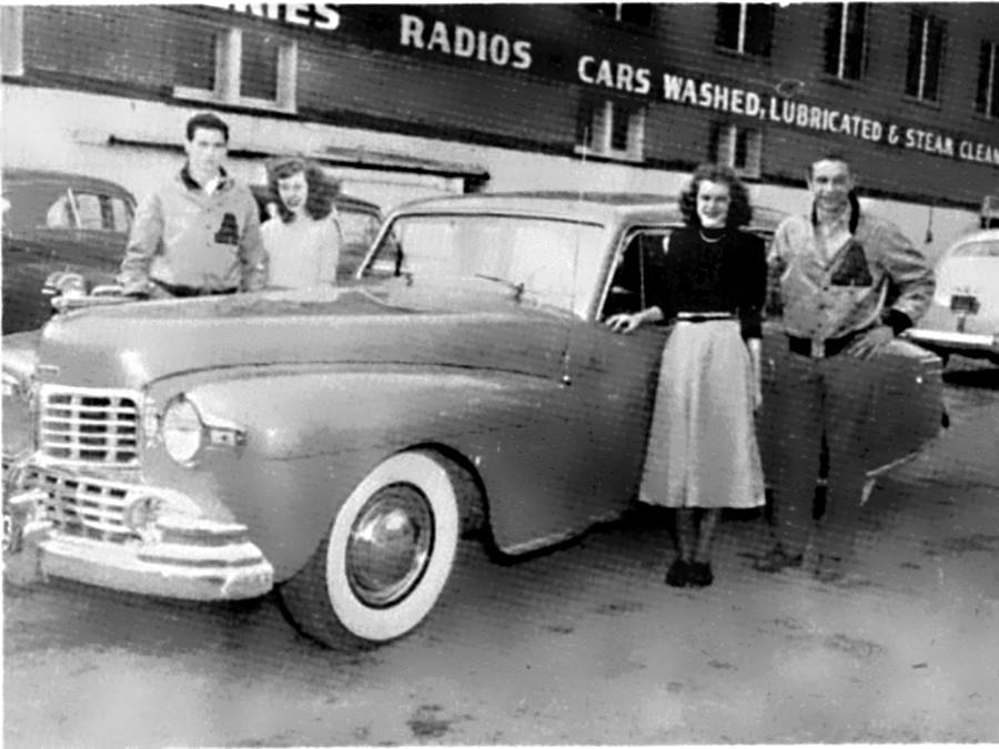 Four Abilene High School Students pose beside car in 1948