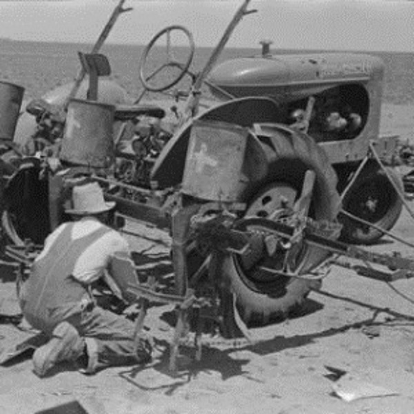 Making the Final Adjustments to Planter in 1939