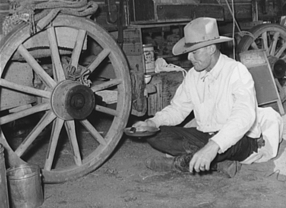 Cowboy Eating in Front of Chuck Wagon in 1939