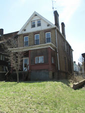 Large 4 bedroom 2 bath foreclosed brick home