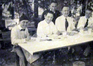GROUP OF MEN AT PICNIC TABLE. LOCKNEY TEXAS 1905