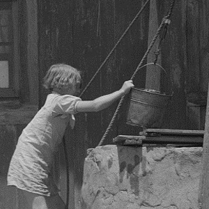 Girl Drawing Water from Well In Hall County Texas in 1939
