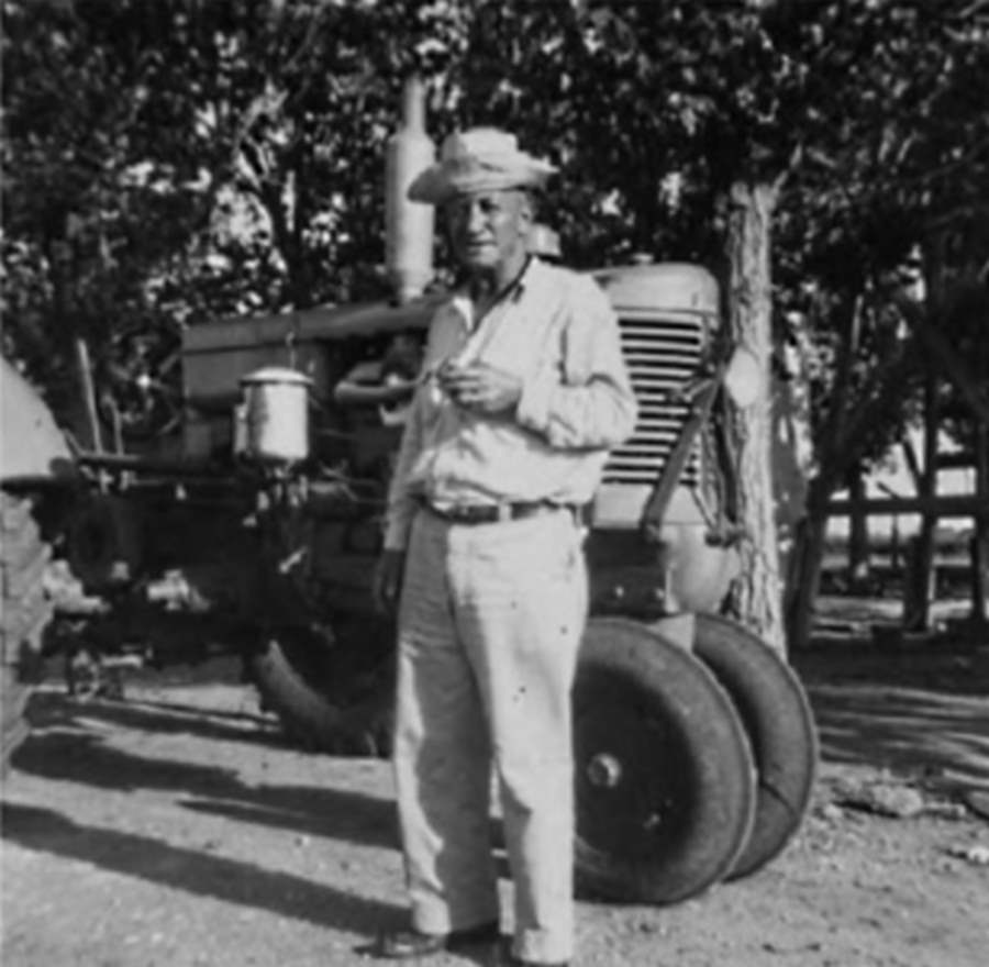 Farmer and  Tractor in Anton Texas in 1949