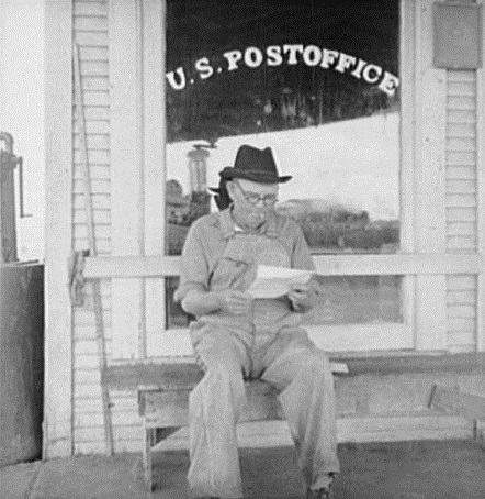Man in front of Carey Texas Post Office in 1937