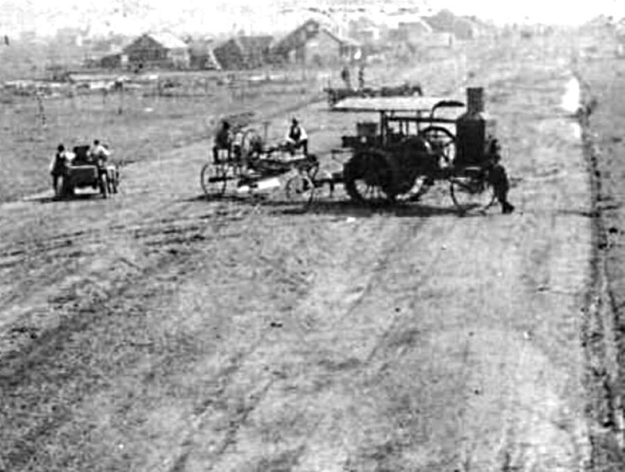 Early Tractor pulls Road Grader in Gray County Texas