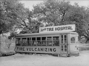 Old streetcar made into tire shop. Kerrville, Tx 1939