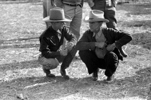 Cowboys talking at horse auction, Eldorado, Tx 1939
